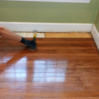 Pulling up flooring that was damaged from water