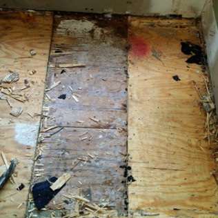 Multiple layers of flooring that we had to pull up to get to the sub floor